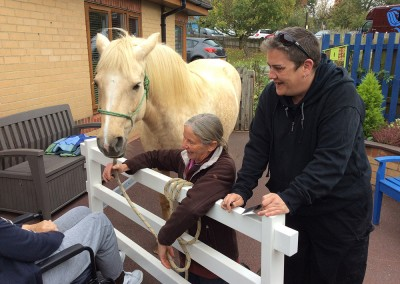 Tippy on a visit with Jo and a learner