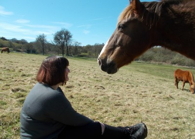 Woman sat with pony